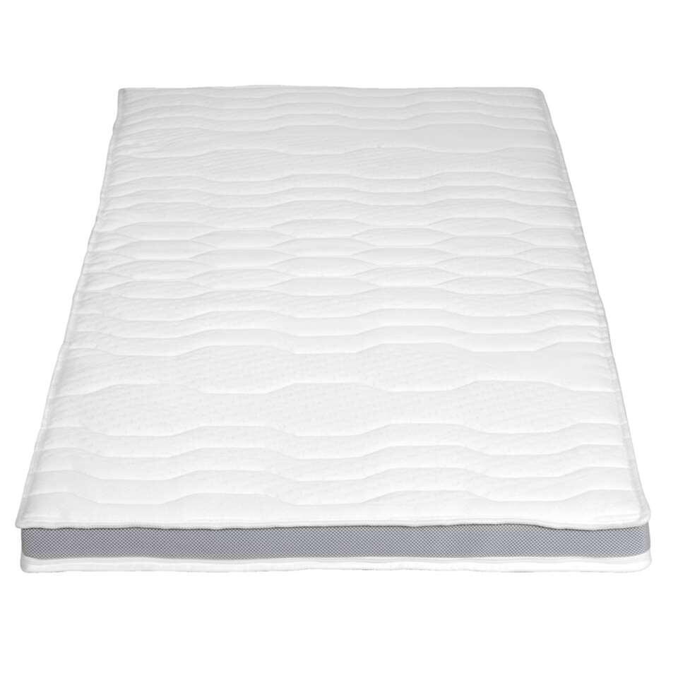 De topdekmatras Deluxe verhoogt het comfort van je matras. Vervaardigd uit koudschuim met een open celstructuur, voelt deze topdekmatras dus niet warm aan.