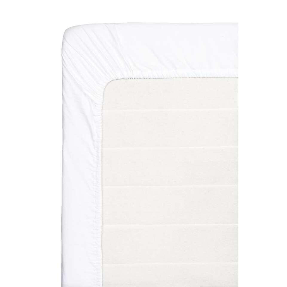 Ce drap-housse doux est fait de coton percale. Ce drap-housse de 180x220 cm est blanc.