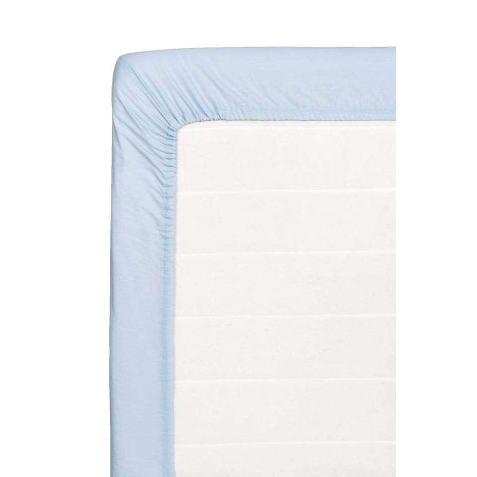 Ce drap-housse doux pour votre matelas est fait de coton. Ce drap-housse de 160x200 cm est bleu clair.