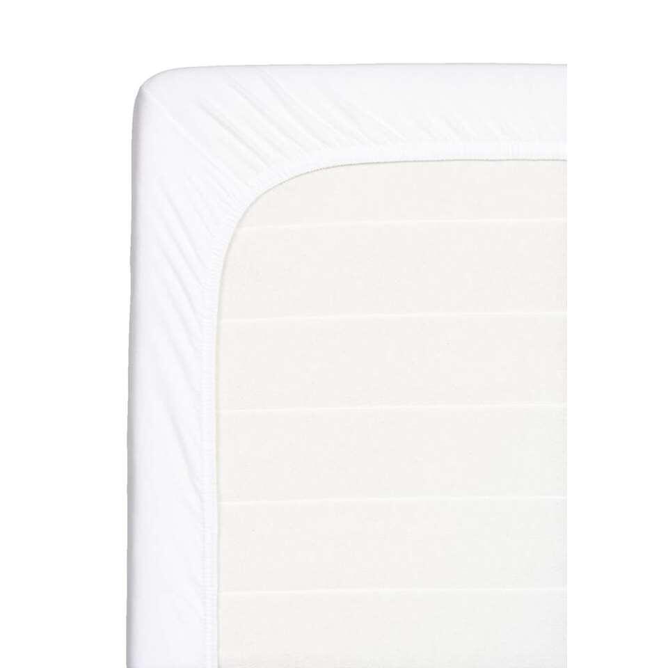 Ce drap-housse doux pour votre surmatelas est fait de coton. Ce drap-housse de 180x200 cm est blanc.