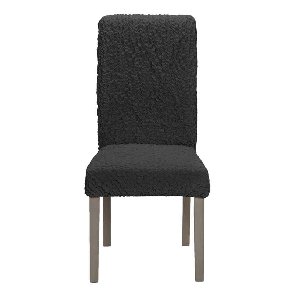 Donnez une autre allure à p.e. vos chaises de salle à manger avec la housse de chaise Josefien. Cette housse a une couleur anthracite et est en coton, polyester et élasthanne.