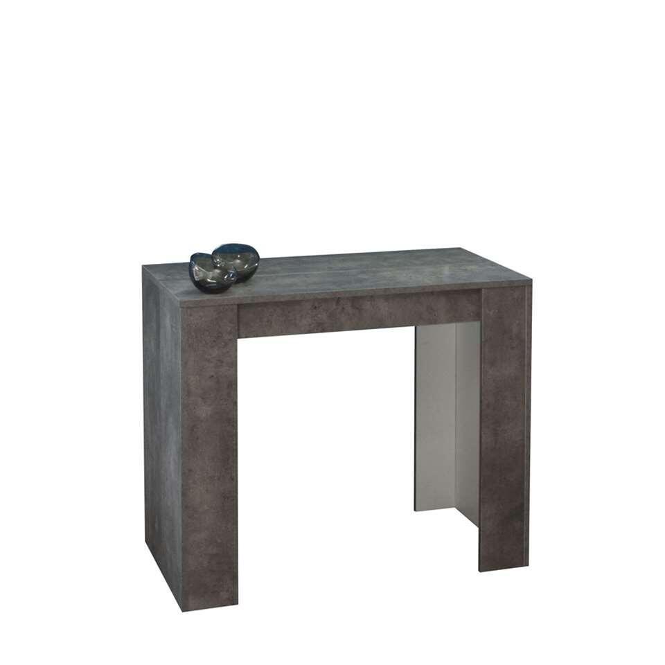 Wandtafel Ruste is gemakkelijk uit te breiden tot een eetkamertafel (van 49 cm naar 198 cm) dankzij drie afzonderlijke verlengbladen. Het meubel is gemaakt van spaanplaat in betongrijs.