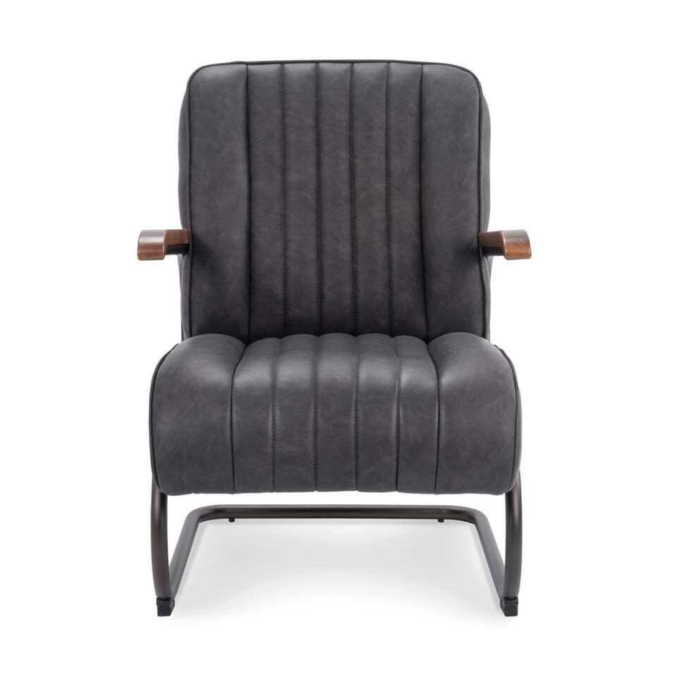 Le fauteuil Miles est en simili cuir vintage robuste de couleur anthracite. Le fauteuil a un look rétro vintage et est super confortable.