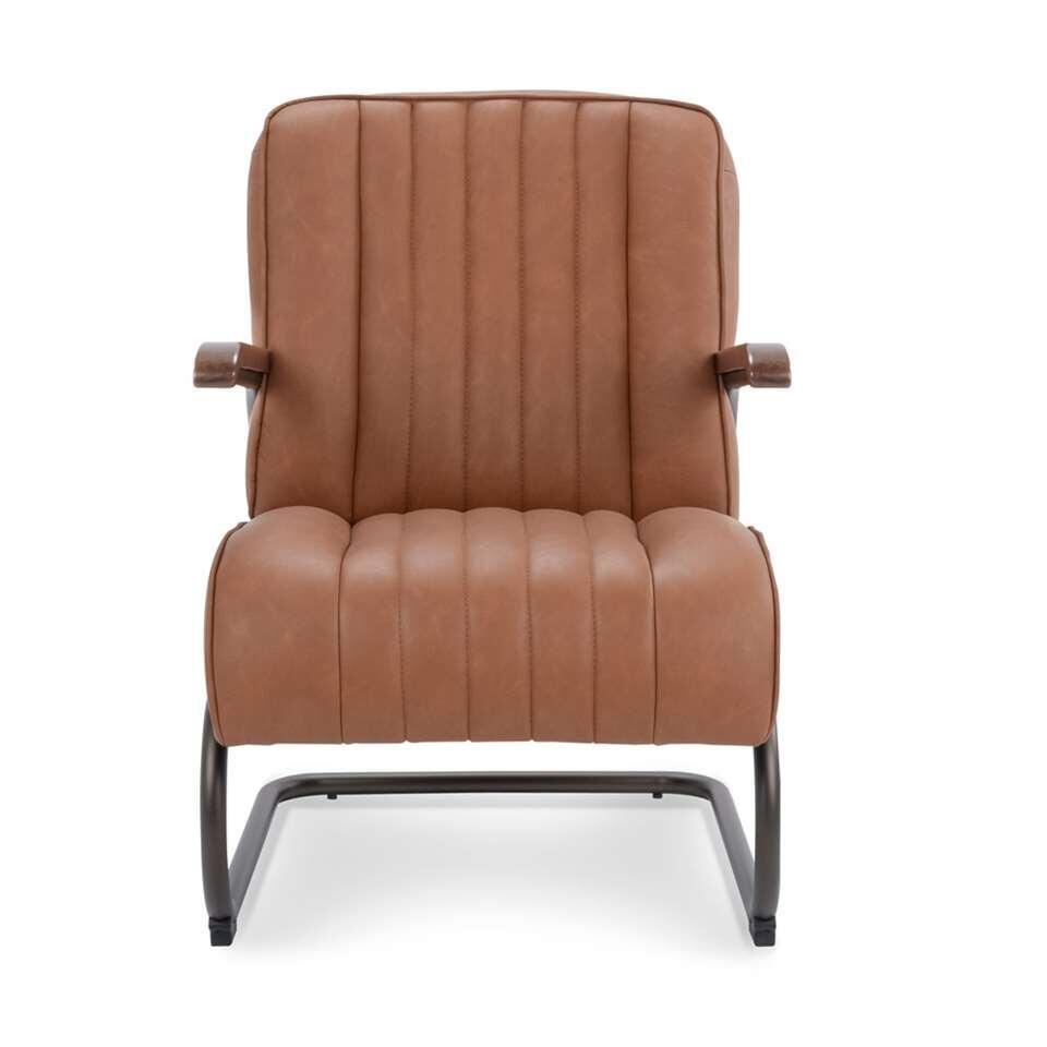 Le fauteuil Miles est en simili cuir vintage robuste de couleur cognac. Le fauteuil a un look rétro vintage et est super confortable.