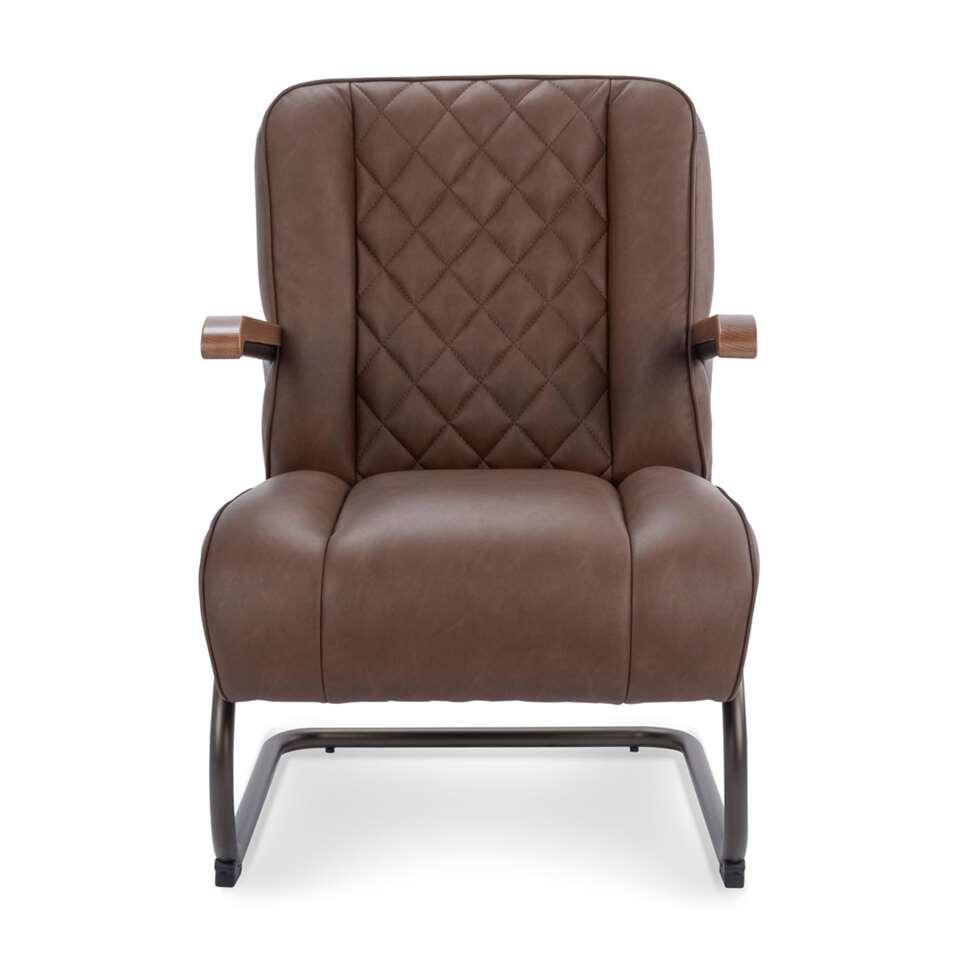 Le fauteuil Lennox est en simili cuir vintage robuste de couleur brun. Le fauteuil a un look rétro vintage et est super confortable.